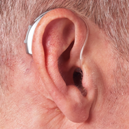 behind-the-ear-artificial-intelligence-hearing-aid-on-ear